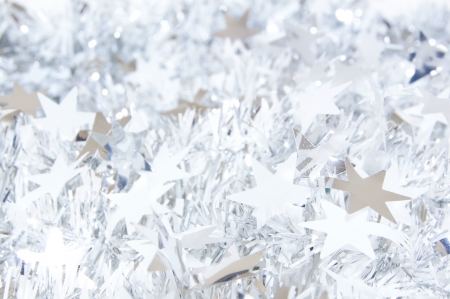 Shiny silver star shaped Christmas garland background photo