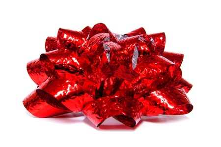 topper: Single shiny red gift bow over white Stock Photo
