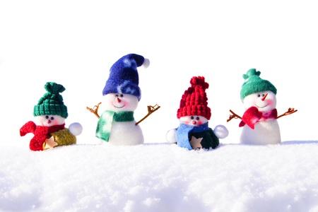 powder snow: Group of unique snowman decorations in resting in fresh snow