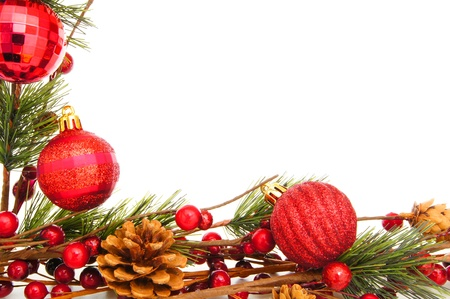 many christmas baubles: Christmas border with baubles, tree branches and berries over white