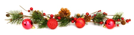 group of christmas baubles: Long horizontal Christmas border with baubles, tree branches and berries over white Stock Photo