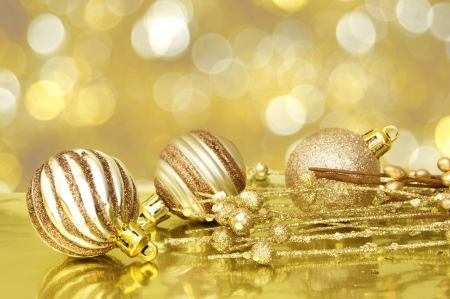 Gold Christmas scene with baubles and abstract light background photo
