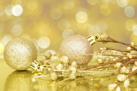 group of christmas baubles: Gold Christmas scene with baubles and abstract light background