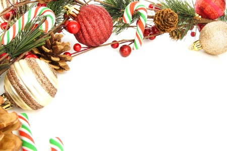 Christmas corner border with baubles, tree branches and candy canes over white Archivio Fotografico
