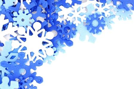 edges: Winter corner border of blue and white snowflake confetti