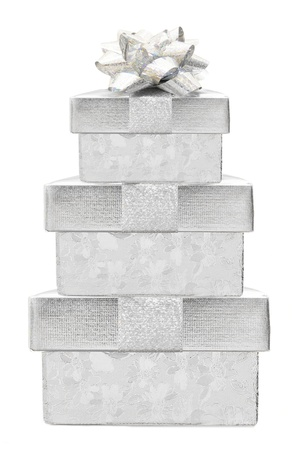 Stacked silver Christmas gift boxes with bow isolated on white photo