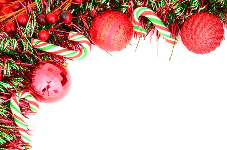 group of christmas baubles: Christmas border of baubles, garland and candy canes