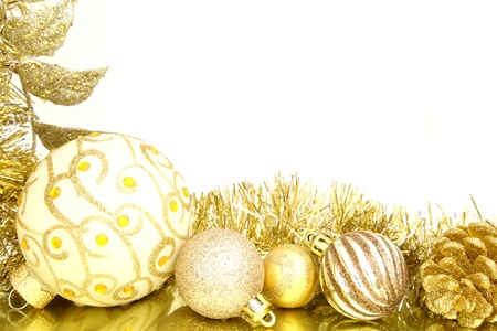 group of christmas baubles: Golden Christmas border of baubles and shiny garland