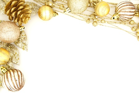 golden christmas: Golden Christmas border of baubles and shiny branches Stock Photo