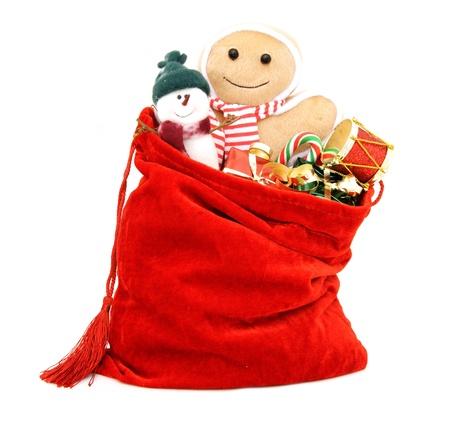 juguetes: Santa s bolsa de regalos llena de juguetes y regalos sobre blanco