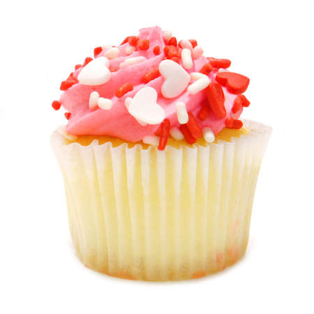 Single pink Valentines Day cupcake with heart-shaped sprinkles over white photo