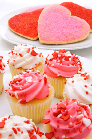 Plate of Valentines Day cupcakes with heart-shaped cookies photo