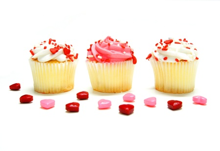 Three Valentines Day cupcakes with candies over white  photo