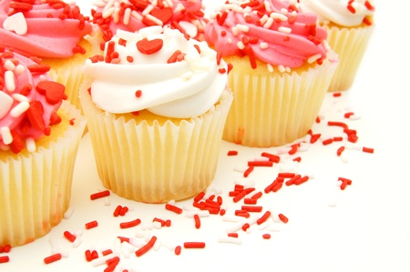Group of pink and white Valentines Day cupcakes with sprinkles photo