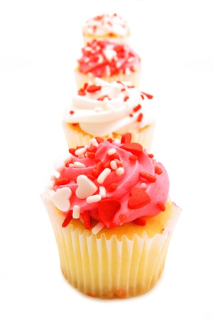 Row of pink and white Valentines Day cupcakes  photo