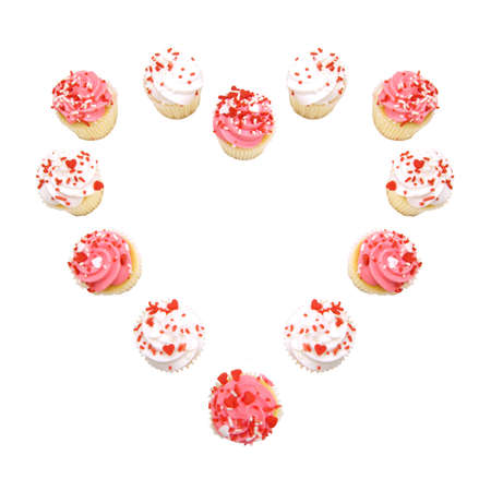Valentines Day cupcakes arranged in a heart shape over white photo