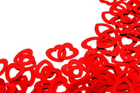 Red heart shaped confetti background or corner border over white photo