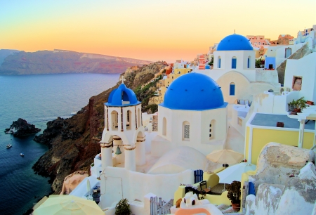 santorini greece: Sunset view of the blue dome churches of Santorini, Greece Stock Photo