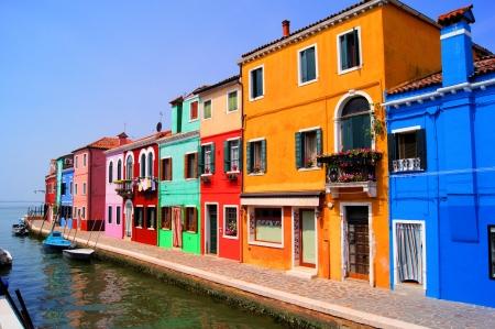 italian village: Colorful houses along a canal in Burano near Venice, Italy Stock Photo