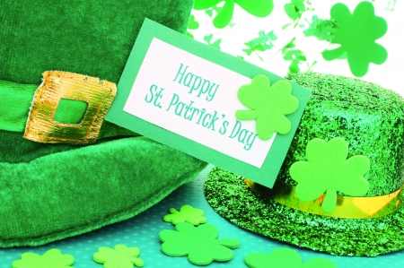 Happy St Patricks Day tag with party hats and shamrocks over white Stock Photo - 17681067