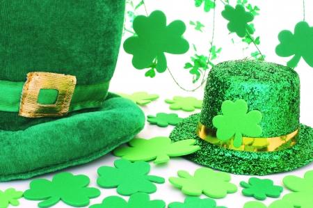 St Patricks Day hats with shamrocks over white