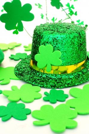 saint paddy's: Shiny St Patricks Day hat with shamrocks over white