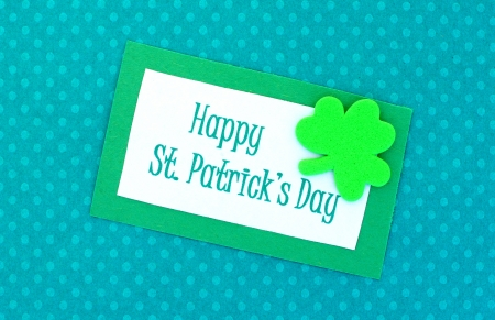 Happy St Patricks Day tag on green polka dot paper background Stock Photo - 17681064