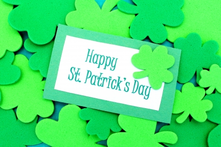 Happy St Patricks Day tag over shamrock background
