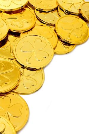 St Patricks Day shamrock gold coin corner border over white Stock Photo - 17681059