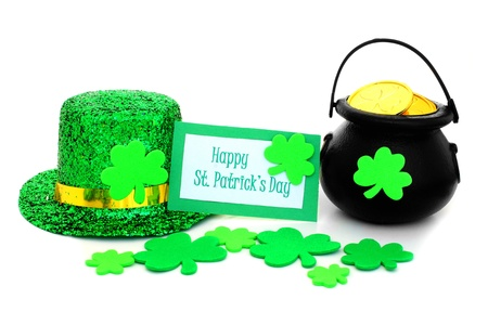 Happy St Patrick s Day tag with pot of gold, hat and shamrocks over white photo