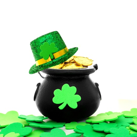 irish culture: St Patricks Day pot of gold with shamrocks and hat over white