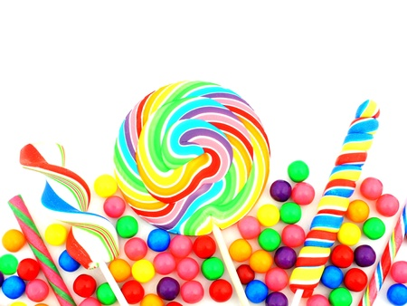Colorful assortment of candy forming a border over white photo