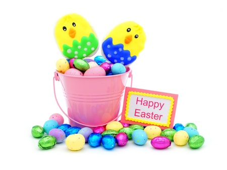 Happy Easter tag and pink pail filled with colorful Easter candy photo