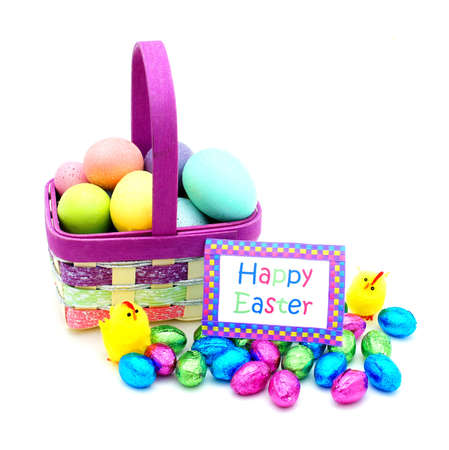 Easter basket close up with colorful eggs, chicks, candy and Happy Easter card photo