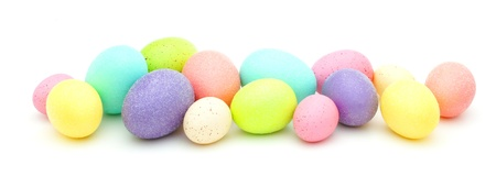 Horizontal border of colorful Easter eggs over white photo