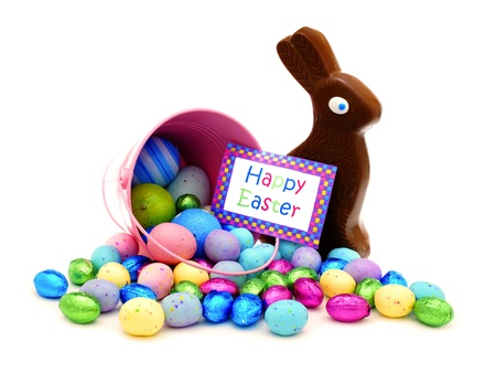 Happy Easter card and pink pail spilling candy photo