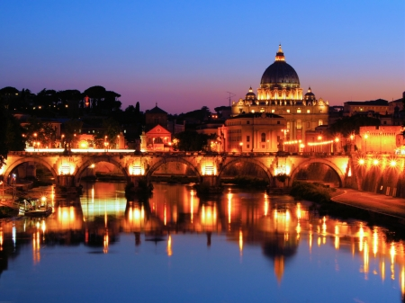 st  peter's basilica pope: Night view of the Vatican across the Tiber River of Rome, Italy