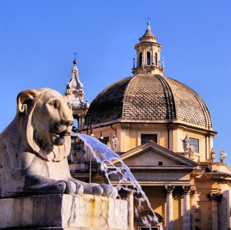 piazza: Lion fountain in Piazza del Popolo with church dome Rome, Italy Stock Photo