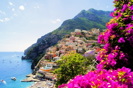 bougainvillea flowers: View of Positano with flowers, Amalfi Coast, Italy