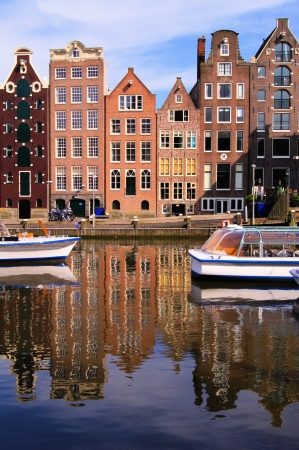 Canal houses of Amsterdam, Netherlands with reflections photo