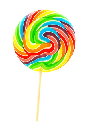 Single multi colored lollipop candy isolated on white photo