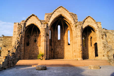 Old church ruins in the old town of Rhodes, Greece photo