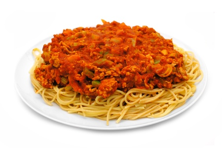 Full plate of spaghetti pasta with tomato and meat sauce over white
