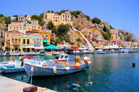 rhodes: Beautiful boat lined harbor at Symi, Greece Stock Photo
