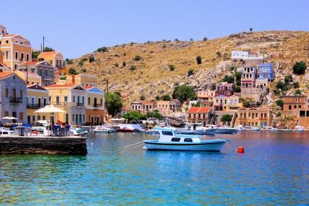 rhodes: Colorful harbor of the Greek village of Symi