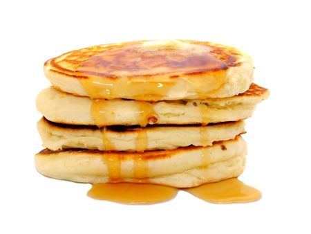 Stack of breakfast pancakes with dripping syrup isolated on white