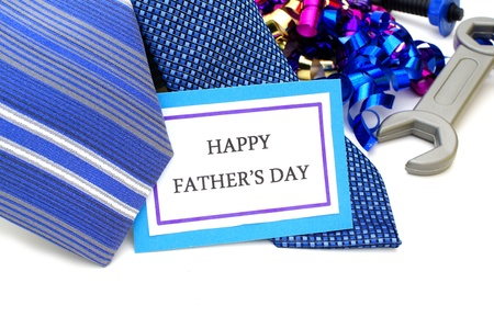 culture day: Happy Fathers Day tag with neckties, tools and ribbon Stock Photo