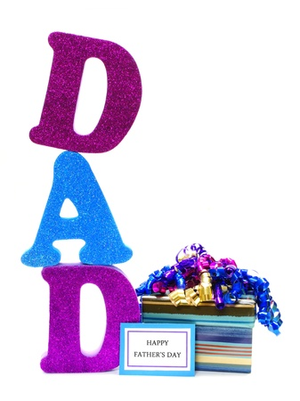 Shiny letters spelling DAD with gift box and Happy Fathers Day tag Foto de archivo