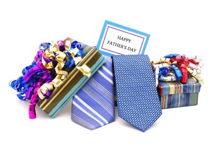 Gelukkig Fathers Day tag met geschenkdozen en banden Stockfoto