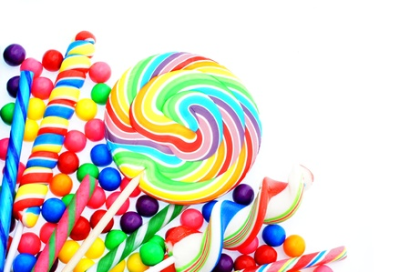candy border: Colorful candy corner border with lollipops and gumballs